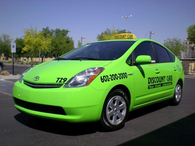 Green Discount Taxi Vehicle